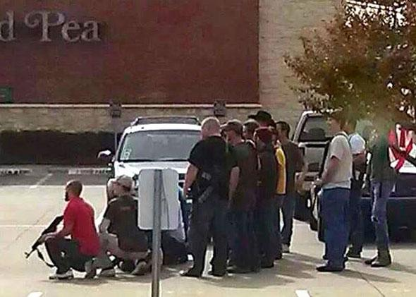 Armed members of Open Carry Texas protest a meeting held by Moms Demand Action in Dallas, Texas.