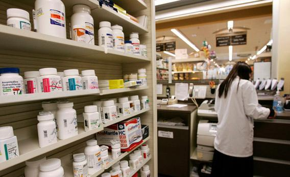 A pharmacist works at a Safeway Pharmacy in Great Falls, Virginia, July 29, 2009.