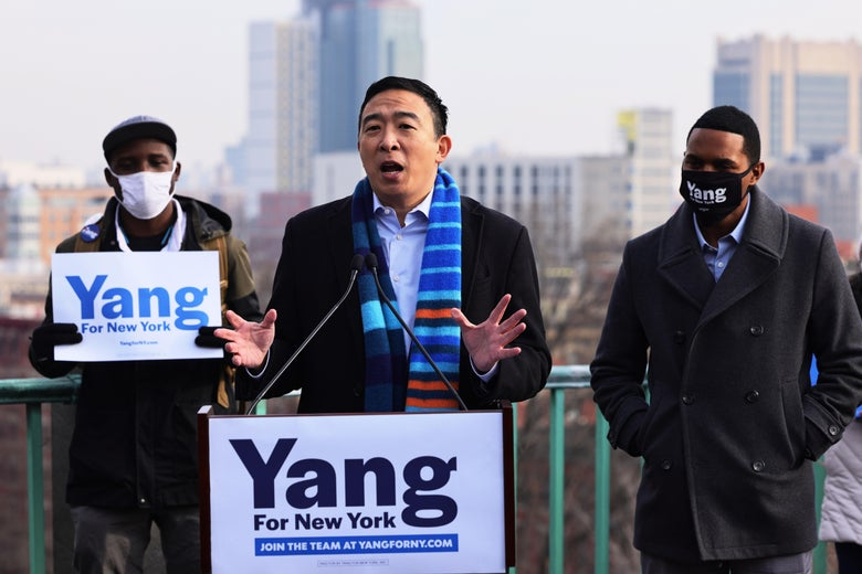 """Andrew Yang speaks from a podium that says """"Yang for New York."""""""