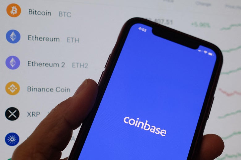 This illustration photo shows the Coinbase logo on a smartphone in Los Angeles on April 13, 2021. - The arrival April 13, 2021, of cryptocurrency exchange Coinbase on Nasdaq is one of the most anticipated events of the year on Wall Street, where enthusiasm for record-breaking bitcoin is in full swing, despite questions about the sustainability of the market. (Photo by Chris DELMAS / AFP) (Photo by CHRIS DELMAS/AFP via Getty Images)