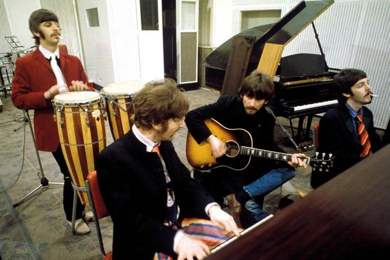 The Beatles working in a studio.