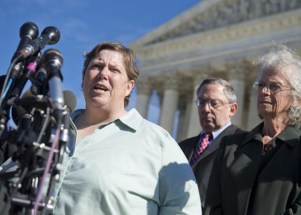 Susan Galloway (L) speaks to the media following oral arguments in the case of Town of Greece v. Galloway dealing with prayer in government.