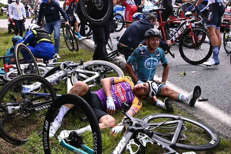 Riders side and lay on the ground besides their crashed bikes.