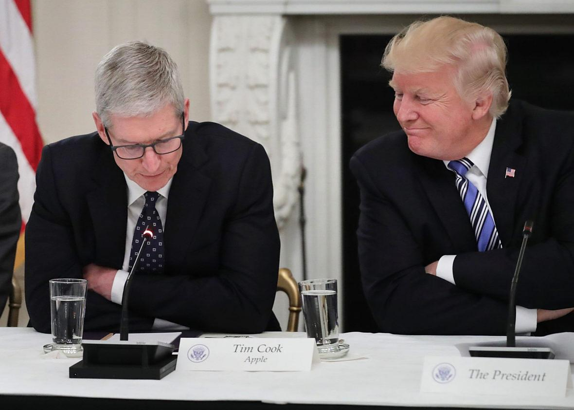 Apple CEO Tim Cook delivers brief remarks as U.S. President Donald Trump
