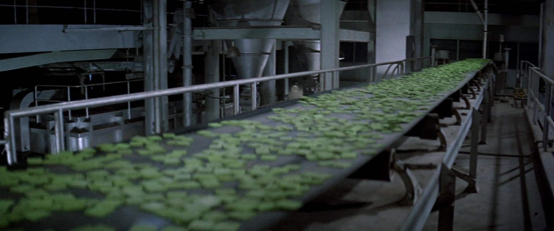 A still from the film Soylent Green, showing a conveyor belt transporting Soylent Green.