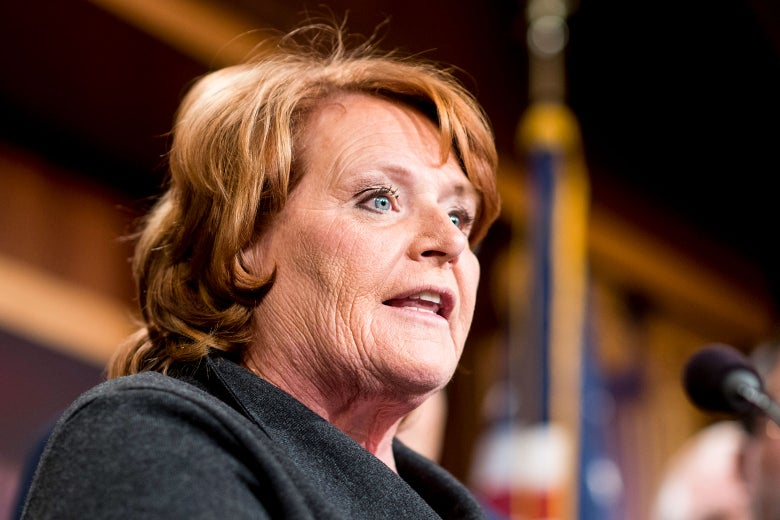 Sen. Heidi Heitkamp speaks into a microphone.