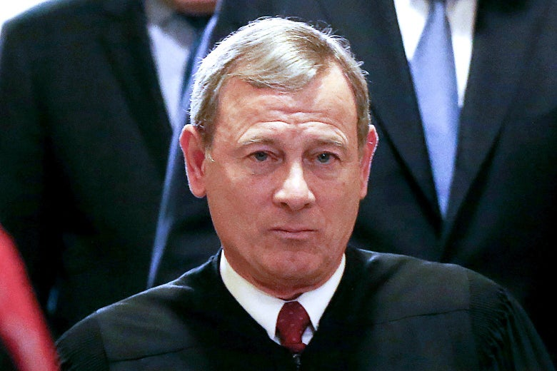 John Roberts wearing a robe and looking straight ahead.