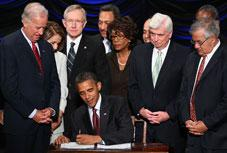 President Barack Obama signs the Dodd-Frank Wall Street Reform and Consumer Protection Act. Click to expand image.