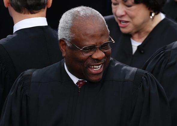 U.S. Supreme Court Justice Clarence Thomas arrives for inauguration ceremonies on the West front of the U.S. Capitol in Washington, January 21, 2013.