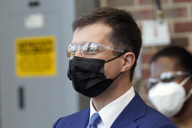 Pete Buttigieg wearing safety glasses and a mask at a demonstration in the engineering department at North Carolina State University on April 30