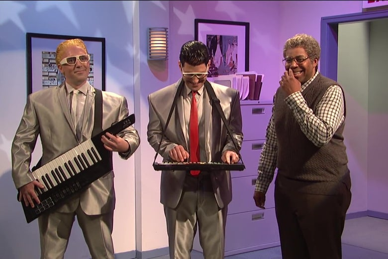 Beck Bennett, Paul Rudd, and Kenan Thompson perform on SNL.