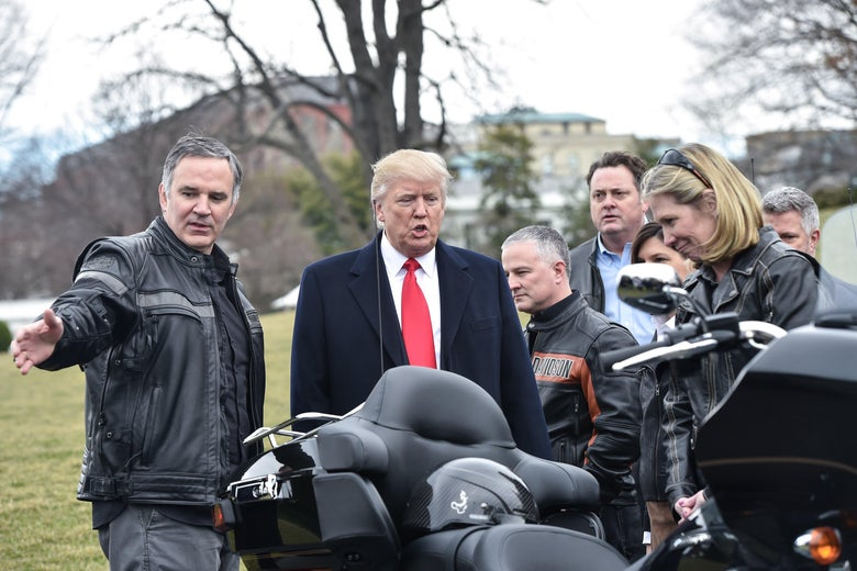 Harley Davidson CEO Matthew Levatich speaks with President Donald Trump as Trump greets Harley Davidson executives and union representatives at the White House on Feb. 2, 2017.