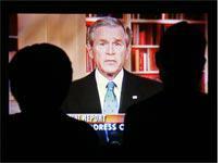 People watch Bush's Iraq speech. Click image to expand.