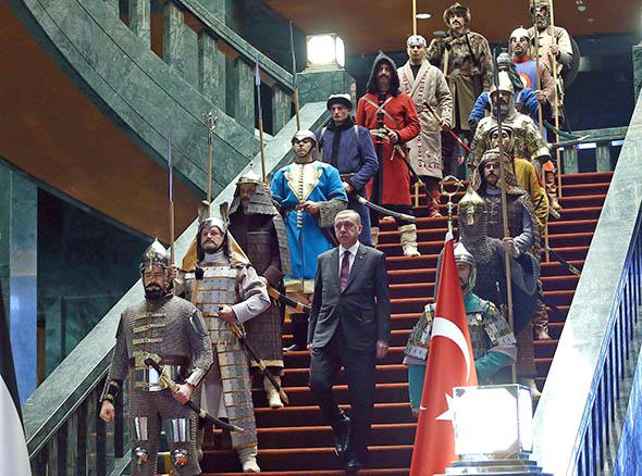 Turkish President Recep Tayyip Erdogan poses in front of the 16 soldiers who represent the 16 Turkish states that have been founded throughout history, during the visit of the Palestinian President Mahmoud Abbas (not seen) at the Turkish presidential palace in Ankara, on January 12, 2015.