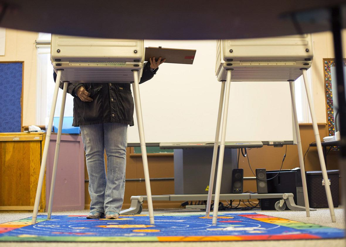 A voter casts her ballot.