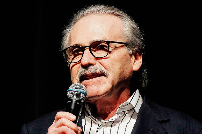 Pecker speaks into a microphone.