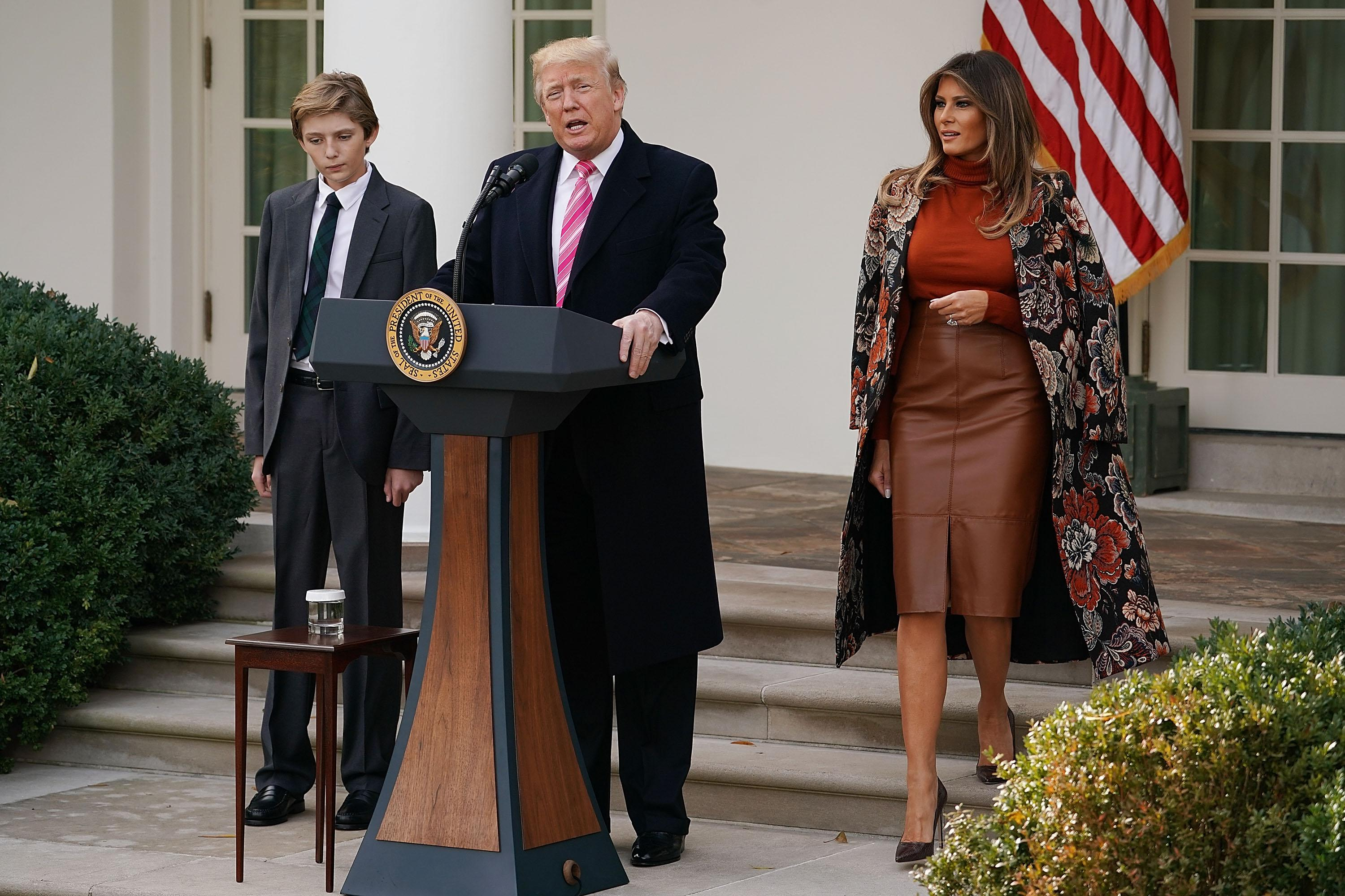 WASHINGTON, DC - NOVEMBER 21:  U.S. President Donald Trump delivers remarks with his son Barron Trump and first lady Melania Trump before pardoning the National Thanksgiving Turkey in the Rose Garden at the White House November 21, 2017 in Washington, DC. Following the presidential pardon, 'Drumstick,' the 40-pound White Holland breed which was raised by Turkey Federation Chairman Carl Wittenburg in Minnesota, will then reside at his new home, 'Gobbler's Rest,' at Virginia Tech.  (Photo by Chip Somodevilla/Getty Images)