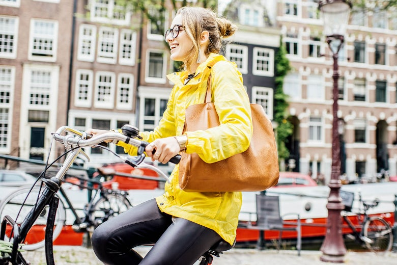 Stock image of a woman on a bicycle in Amsterdam, Netherlands.