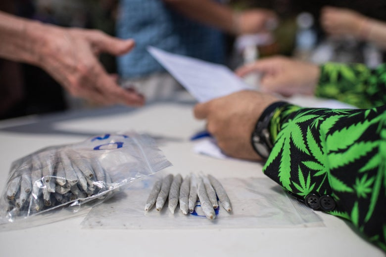 Marijuana activists hand out free joints to vaccinated New Yorkers on April 20, 2021 in New York City. (Photo by Angela Weiss / AFP) (Photo by ANGELA WEISS/AFP via Getty Images)