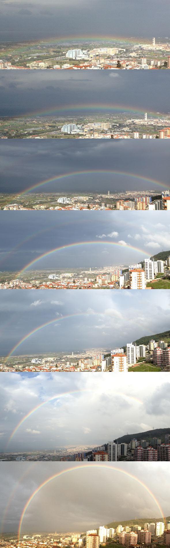 A rainbow rises