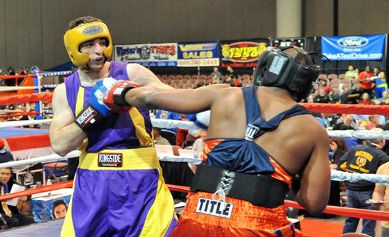 Tamerlan Tsarnaev (L) fights Lamar Fenner (R) during the 201-pound division boxing match during the 2009 Golden Gloves National Tournament of Champions May 4, 2009 in Salt Lake City, Utah.
