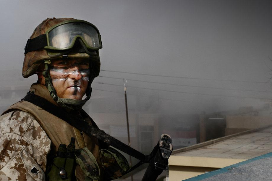 U.S. Marines of Weapons Company, 1st Marine Expeditionary Force (I MEF), clear civilians from the area during the first day of an all-out military offensive against Iraqi insurgents north east of Fallujah, Al Anbar governorate, Iraq on Nov. 8, 2004. Civilians flee the city under the protection of the marines. Located some 40 miles west of the Iraqi capital, Fallujah has been the epicenter of a resistance that has dogged U.S. and Iraqi forces for over a year. On the eve of November 8th, in an attempt to recapture the city, Operation Phantom Fury commenced and coalition troops pushed into the area from the west and south. Soon, combat engulfed the forces' advance, as insurgents engaged them with sniper fire and RPGs in one of the fiercest battles yet.