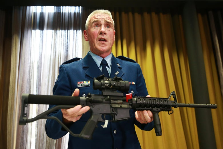 New Zealand official shows the type of gun banned under the new legislation during a press conference April 11, 2019 in Wellington, New Zealand.