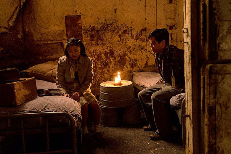 Amy Yoshida and Chester Nakayama speak in an internment camp room in The Terror: Infamy.