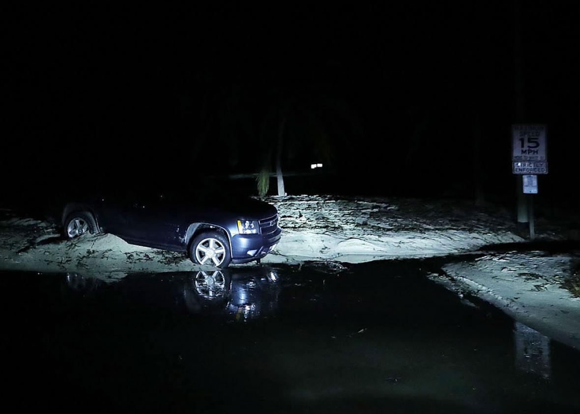 A truck remains stranded in sand and sewage near the southern-most point of the United States two days after Hurricane Irma slammed into the state on September 12, 2017 in Key West, Florida.