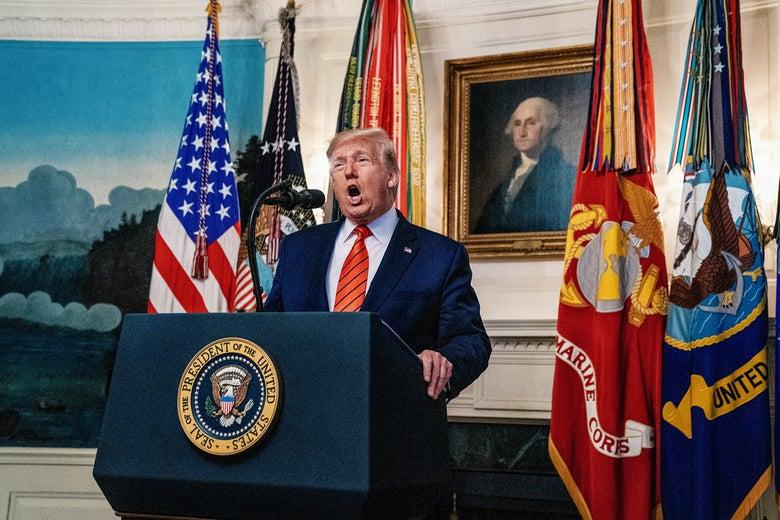 President Donald Trump makes a statement on Sunday in Washington.