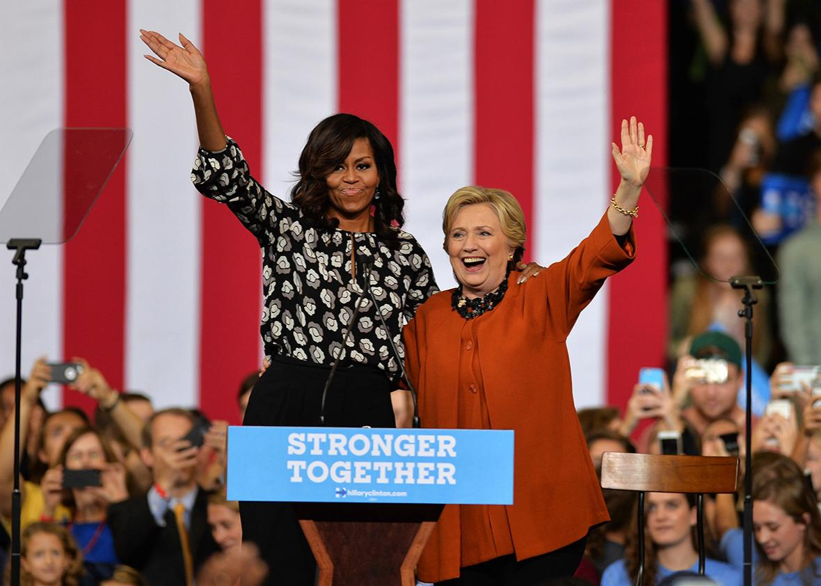 Democratic presidential candidate Hillary Clinton and US First Lady Michelle Obama are seen during a presidential campaign event in Winston-Salem, North Carolina, USA on October 27, 2016.