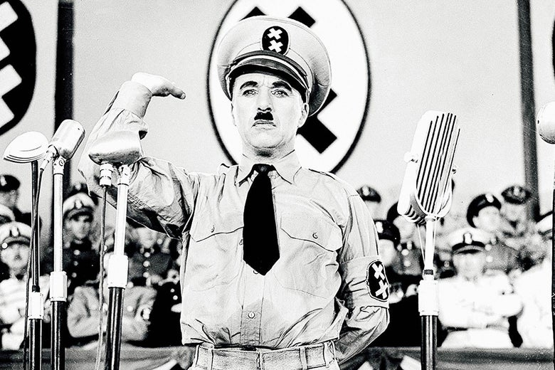 Charlie Chaplin as Hitler in The Great Dictator.