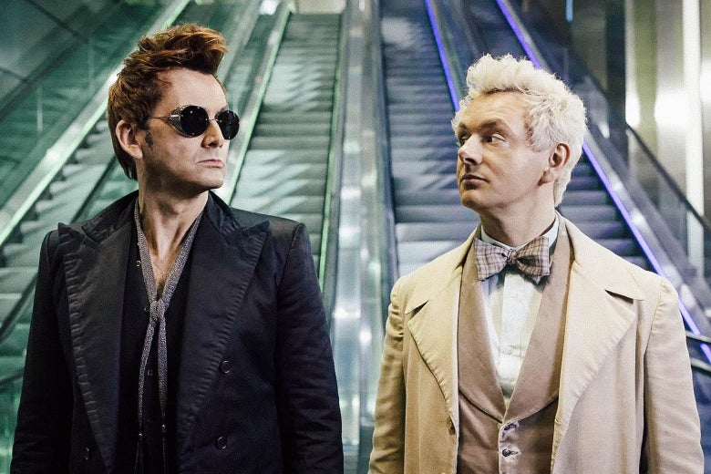 David Tennant as Azriphale and Michael Sheen as Crowley look at each other at the bottom of escalators in this still from Good Omens.