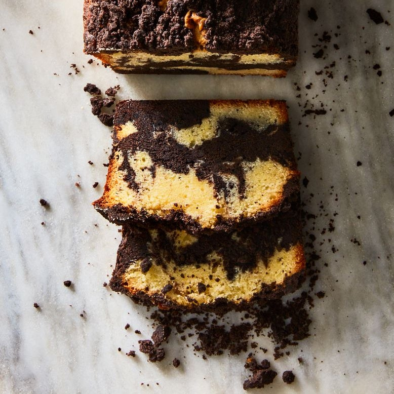A loaf of crumbly marble pound cake, sliced