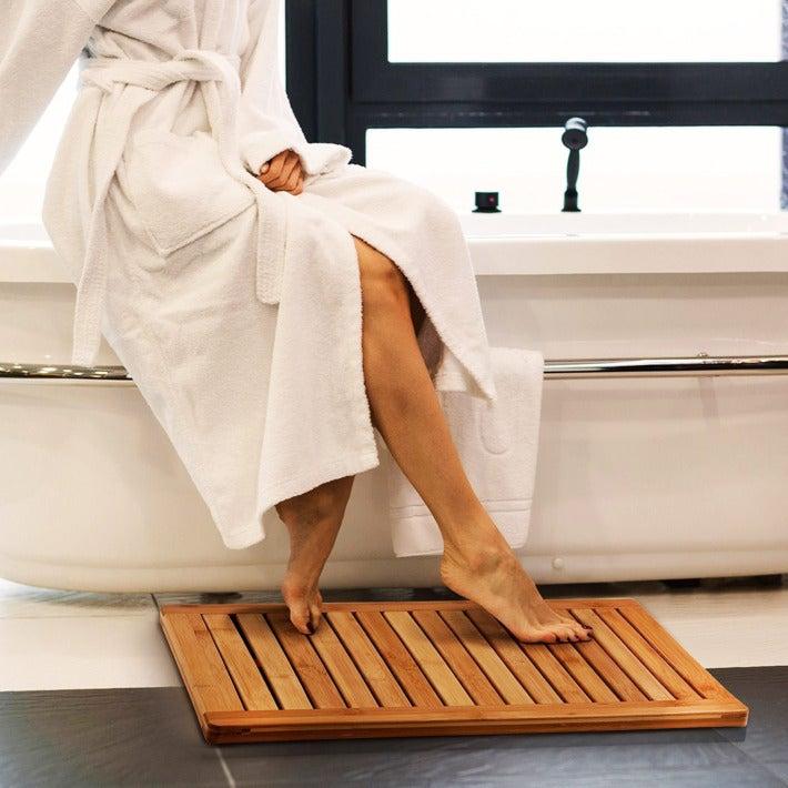 feet on the Bambusi Bamboo Bathroom Shower Floor Mat