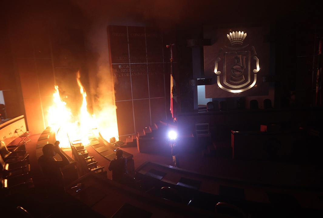 The main hall of the Guerrero state congress is set on fire by protesters in Chilpancingo, Mexico on November 12, 2014.