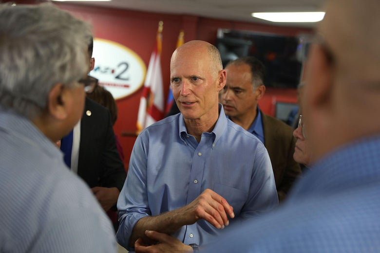 DORAL, FL - MARCH 28:  Florida Governor Rick Scott interacts with people at Restaurant El Arepazo 2 as he holds a bill signing ceremony for legislation to prohibit all state agencies from doing business with any entity that benefits the Venezuelan regime on March 28, 2018 in Doral, Florida. Gov. Scott said recently that he will have a big announcement on April 9, with many speculating that he will launch a Senate bid to challenge incumbent Democratic Sen. Bill Nelson for the seat.  (Photo by Joe Raedle/Getty Images)