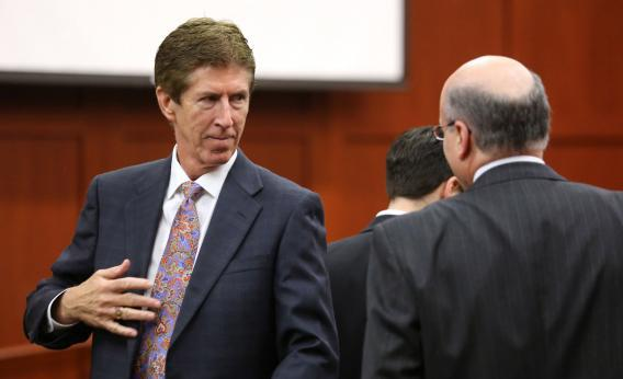 Defense attorney Mark O'Mara talks to prosecutor Bernie de la Rionda on the day of closing arguments in George Zimmerman's trial.
