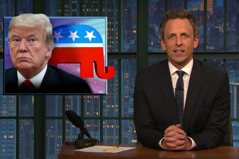 Seth Meyers, in front of a picture of Donald Trump.