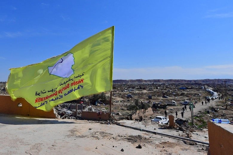 "An image taken on March 23, 2019 shows the US-backed Syrian democratic forces (SDF) flags on a building in the Islamic state group's last bastion in the Eastern Syrian village of Baghuz after defeating the jihadist group. ""srcset ="" https://compote.slate.com/images/bcca4951-7d6a-476e-ba95-6ed15afb7173.jpeg?width=780&height=520&rect=3120x2080&offset=0x0 1x, https://compote.slate.com/images /bcca4951-7d6a-476e-ba95-6ed15afb7173.jpeg?width=780&height=520&rect=3120x2080&offset=0x0 2x"