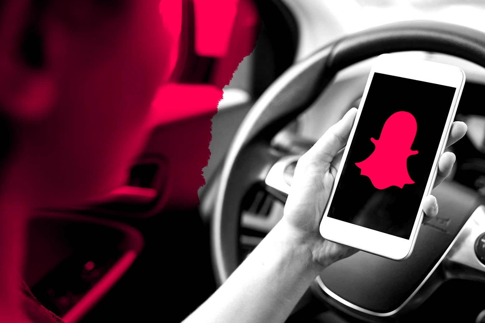 A woman driving and using Snapchat at the same time.