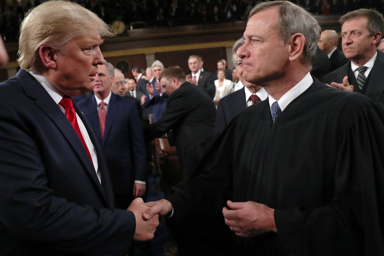Donald Trump shakes hands with John Roberts before the State of the Union address in the House chamber on February 4