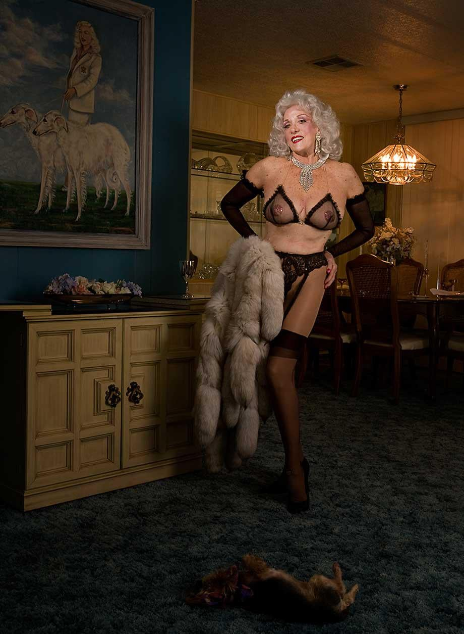 Joan Arline was known as the Sexquire girl, was photographed in her home in Twenty-Nine Palms, California, wearing the same outfit she performed in fifty-five years previously. She told me that the portrait of her on the wall was a gift from an admirer. She passed away in October of 2011 from leukemia.