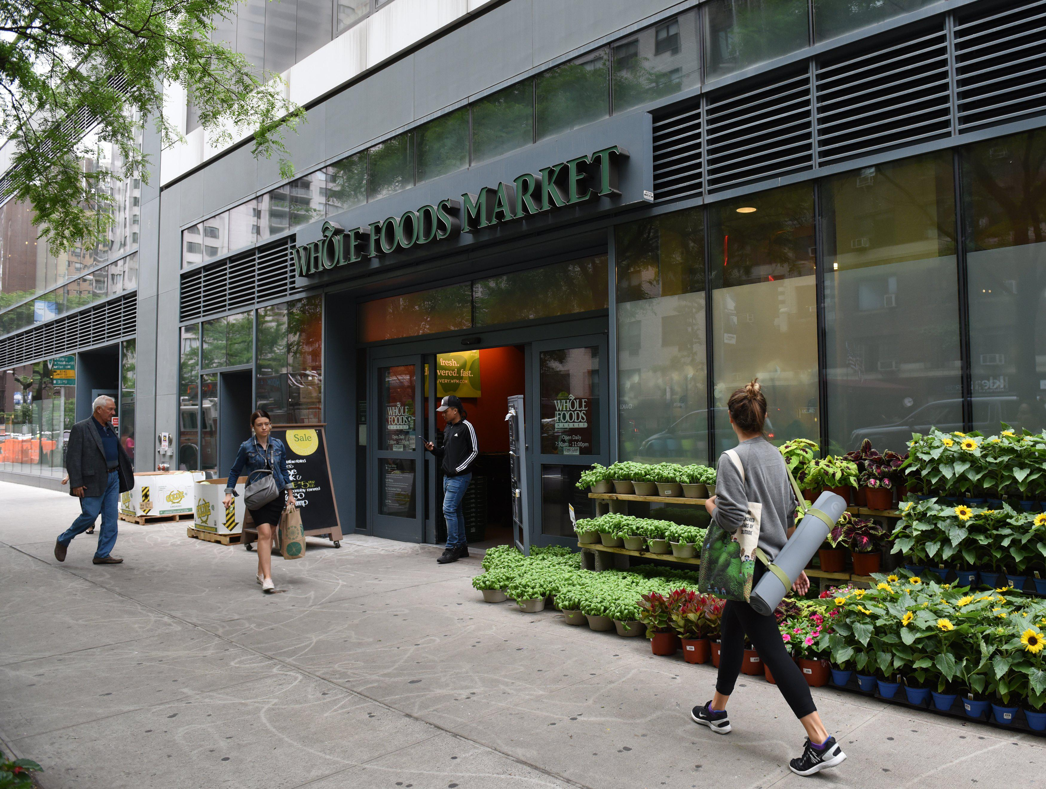 The Whole Foods Market in Midtown New York is seen on June 16, 2017.          Amazon is once again shaking up the retail sector, with the announcement Friday it will acquire upscale US grocer Whole Foods Market, known for its pricey organic options,  in a deal that underscores the online giant's growing influence in the economy. / AFP PHOTO / TIMOTHY A. CLARY        (Photo credit should read TIMOTHY A. CLARY/AFP/Getty Images)