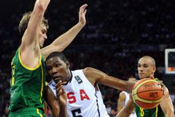 Kevin Durant (R) of USA vies with Tiago Splitter (L) of Brazil. Click image to expand.