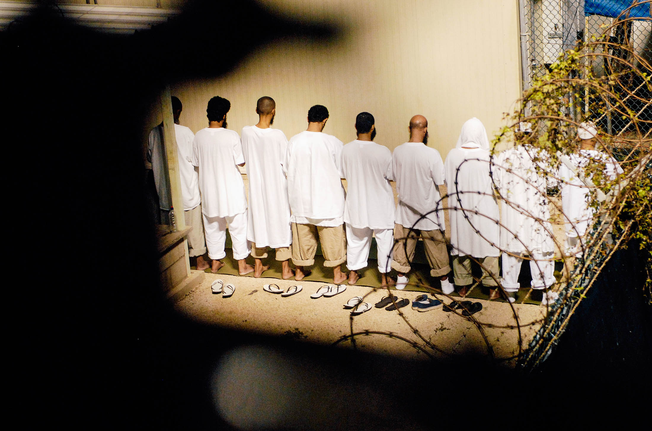 A group of detainees observe morning prayer before sunrise at Guantanamo Bay in an Oct. 28, 2009 file photo provided by the Department of Defense.