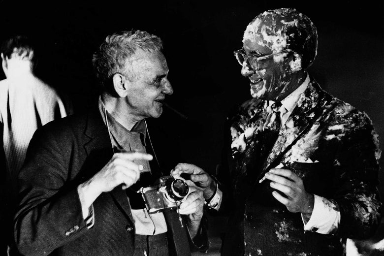 Weegee (left) and Peter Sellers, covered in custard and holding a cigarette, after the pie fight on the set of Dr. Strangelove.