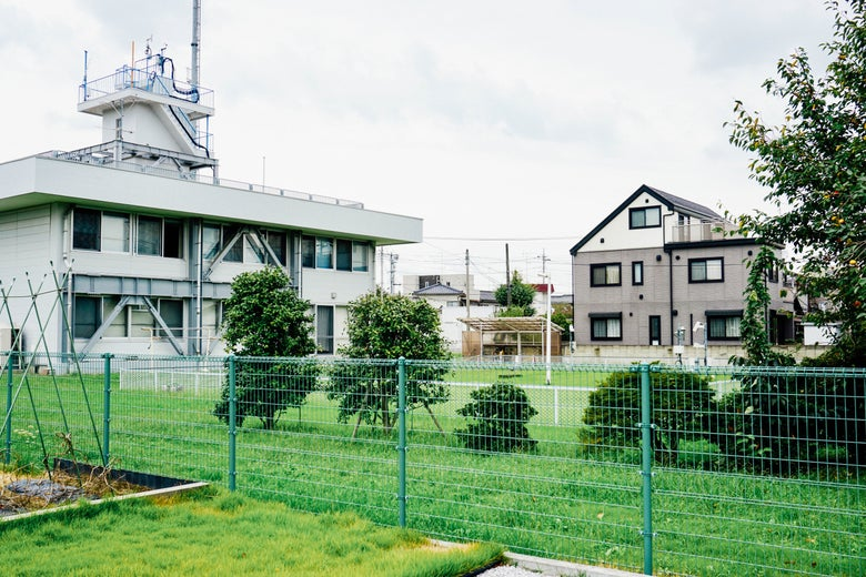 A building behind a fence in Japan