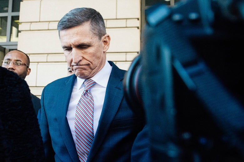 Michael Flynn leaves after the delay in his sentencing hearing in Washington on Tuesday.