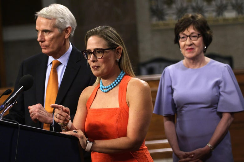 WASHINGTON, DC - JULY 28:  U.S. Sen. Rob Portman (R-OH) (L) and Sen. Kyrsten Sinema (D-AZ) (2nd L) answer questions from members of the press as Sen. Susan Collins (R-ME) looks on during a news conference after a procedural vote for the bipartisan infrastructure framework at Dirksen Senate Office Building July 28, 2021 on Capitol Hill in Washington, DC. The Senate has advanced the bipartisan infrastructure framework with the vote of 67-32. (Photo by Alex Wong/Getty Images)